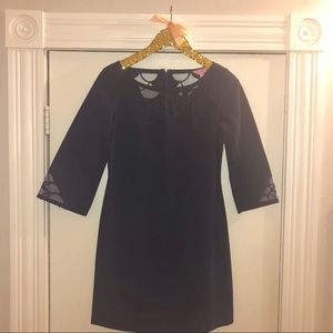 Navy long sleeve shift dress with flower detail